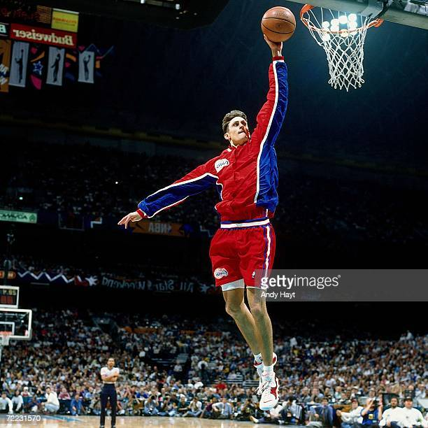 Brent Barry of the Los Angeles Clippers attempts a dunk during the 1996 Slam Dunk Contest on February 10 1996 at the Alamodome in San Antonio Texas...