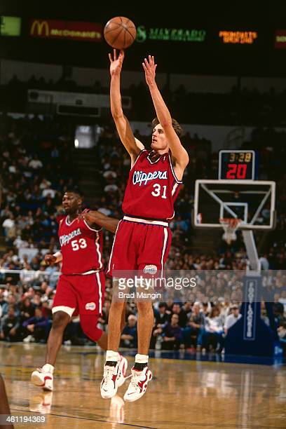 Brent Barry of the Los Angeles Clippers shoots the ball circa 1998 at Arco Arena in Sacramento California NOTE TO USER User expressly acknowledges...