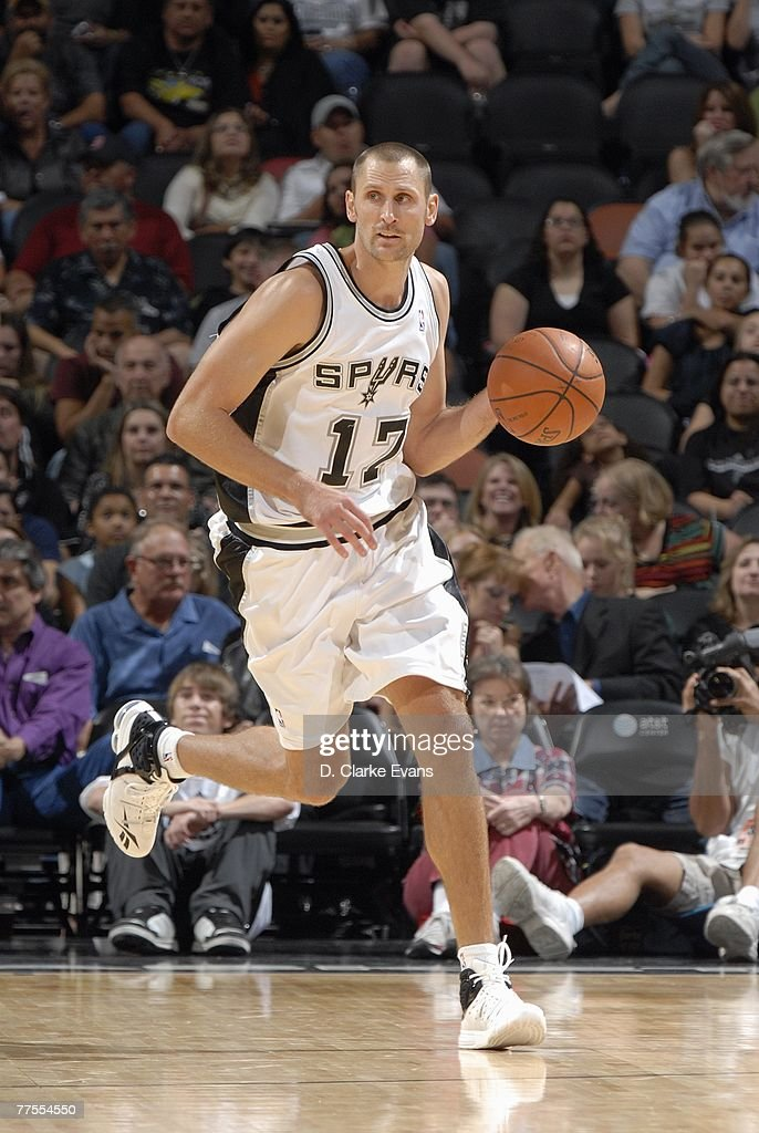 Brent Barry #17 of the San Antonio Spurs mves the ball up court during a preseason game against the Detroit Pistons at AT&T Center on October 20, 2007 in San Antonio, Texas. The Spurs won 104-80.
