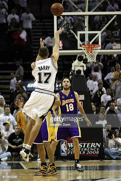 Brent Barry of the San Antonio Spurs shoots and misses the final shot over Derek Fisher of the Los Angeles Lakers in Game Four of the Western...