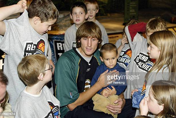 Brent Barry of the Seattle Sonics talks with children during the Sonics Read to Achieve at the Pacific Science Center on October 21 2003 in Seattle...