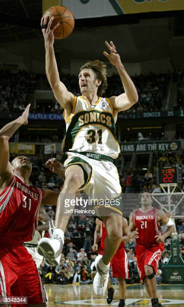 Brent Barry of the Seattle SuperSonics goes to the basket against the Houston Rockets on April 12 2004 at Key Arena in Seattle Washington NOTE TO...