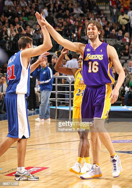 Brent Barry Pau Gasol and Marie FerdinandHarris of Team Los Angeles high five during the Haier Shooting Stars contest on AllStar Saturday Night as...