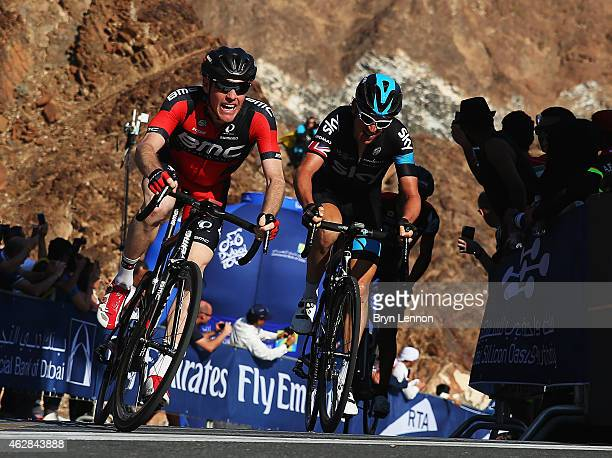 Brent Bookwalter of the USA and the BMC Racing Team and Geraint Thomas of Great Britain and Team SKY cross the finish line on stage three of the...