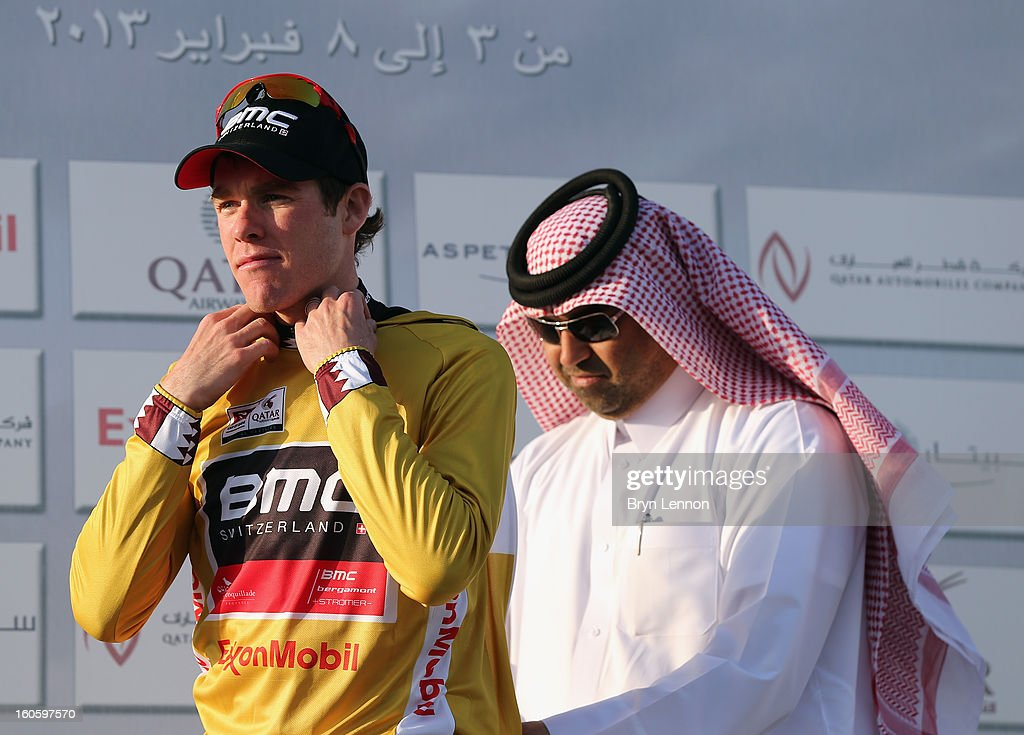Brent Bookwalter of the USA and the BMC Racing Team pulls on the race leader's gold jersey after winning stage one of the 2013 Tour of Qatar from Katara Cultural Village to Dukhan Beach on February 3, 2013 in Dukhan Beach, Qatar.