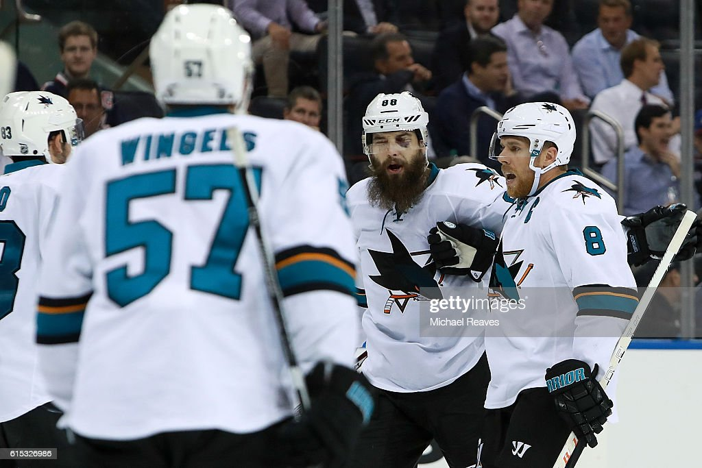 Brent Burns #88 and Joe Pavelski #8 of the San Jose Sharks celebrate after a goal against the New York Rangers during the third period at Madison Square Garden on October 17, 2016 in New York City.