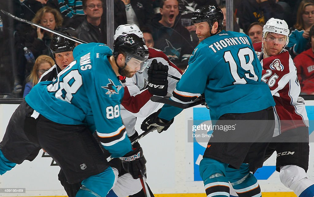 <a gi-track='captionPersonalityLinkClicked' href=/galleries/search?phrase=Brent+Burns&family=editorial&specificpeople=212883 ng-click='$event.stopPropagation()'>Brent Burns</a> #88 and <a gi-track='captionPersonalityLinkClicked' href=/galleries/search?phrase=Joe+Thornton&family=editorial&specificpeople=201829 ng-click='$event.stopPropagation()'>Joe Thornton</a> #19 of the San Jose Sharks goes in for a shot on net against <a gi-track='captionPersonalityLinkClicked' href=/galleries/search?phrase=Erik+Johnson+-+Ice+Hockey+Player&family=editorial&specificpeople=457696 ng-click='$event.stopPropagation()'>Erik Johnson</a> #6 and <a gi-track='captionPersonalityLinkClicked' href=/galleries/search?phrase=Paul+Stastny&family=editorial&specificpeople=2494330 ng-click='$event.stopPropagation()'>Paul Stastny</a> #26 of the Colorado Avalanche during an NHL game on December 23, 2013 at SAP Center in San Jose, California.