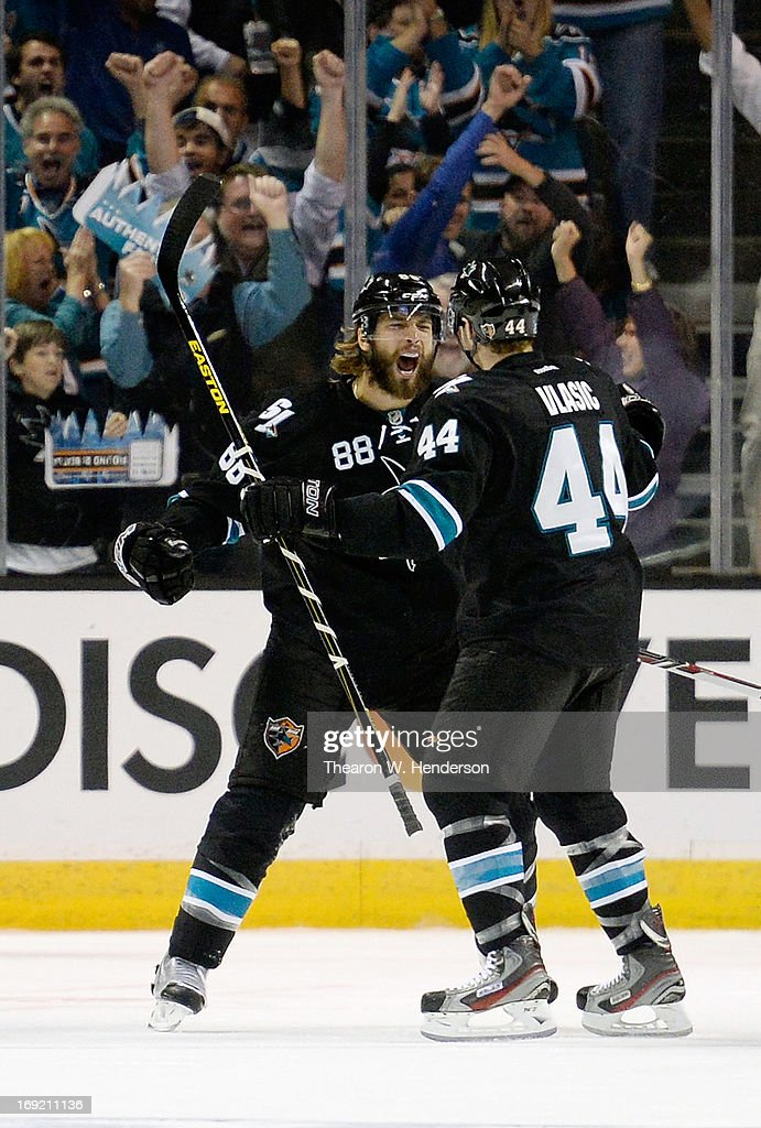 <a gi-track='captionPersonalityLinkClicked' href=/galleries/search?phrase=Brent+Burns&family=editorial&specificpeople=212883 ng-click='$event.stopPropagation()'>Brent Burns</a> #88 and <a gi-track='captionPersonalityLinkClicked' href=/galleries/search?phrase=Marc-Edouard+Vlasic&family=editorial&specificpeople=880807 ng-click='$event.stopPropagation()'>Marc-Edouard Vlasic</a> #44 of the San Jose Sharks celebrate after Burns scored a goal against the Los Angeles Kings in the first period in Game Four of the Western Conference Semifinals during the 2013 NHL Stanley Cup Playoffs at HP Pavilion on May 21, 2013 in San Jose, California.
