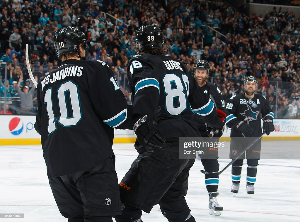 <a gi-track='captionPersonalityLinkClicked' href=/galleries/search?phrase=Brent+Burns&family=editorial&specificpeople=212883 ng-click='$event.stopPropagation()'>Brent Burns</a> #88, <a gi-track='captionPersonalityLinkClicked' href=/galleries/search?phrase=Andrew+Desjardins&family=editorial&specificpeople=2748431 ng-click='$event.stopPropagation()'>Andrew Desjardins</a> #10, Joe Thornton #19 and <a gi-track='captionPersonalityLinkClicked' href=/galleries/search?phrase=Dan+Boyle&family=editorial&specificpeople=201502 ng-click='$event.stopPropagation()'>Dan Boyle</a> #22 of the San Jose Sharks celebrate a goal by Burns against the Detroit Red Wings during an NHL game on March 28, 2013 at HP Pavilion in San Jose, California.