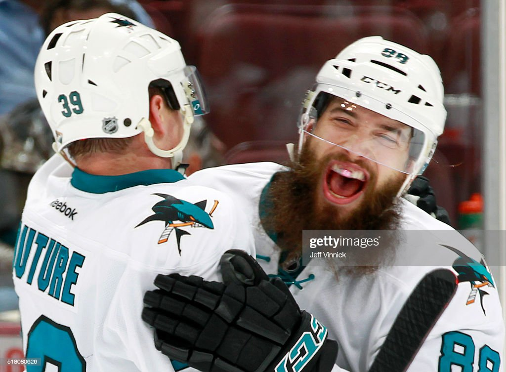 Brent Burns #88 congratulates Logan Couture #39 of the San Jose Sharks who scored three goals against the Vancouver Canucks during their NHL game at Rogers Arena March 29, 2016 in Vancouver, British Columbia, Canada. San Jose won 4-1.