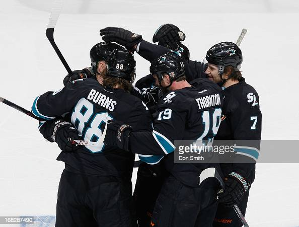 Brent Burns Joe Thornton and Brad Stuart of the San Jose Sharks celebrate a goal against the Vancouver Canucks in Game Four of the Western Conference...