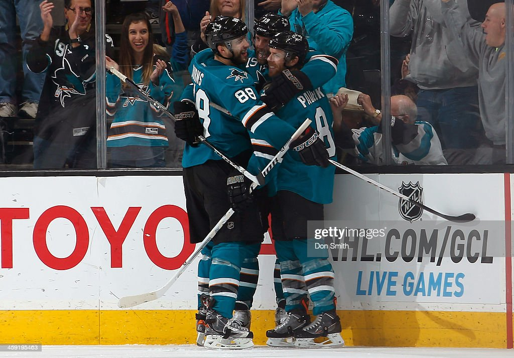 Brent Burns #88, Joe Thornton #19 and Joe Pavelski #8 of the San Jose Sharks celebrate after a goal against the Colorado Avalanche during an NHL game on December 23, 2013 at SAP Center in San Jose, California.
