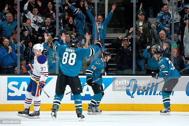 Brent Burns Kevin Labanc and Logan Couture of the San Jose Sharks celebrate LaBancs game winning overtime goal during a NHL game against the Edmonton...