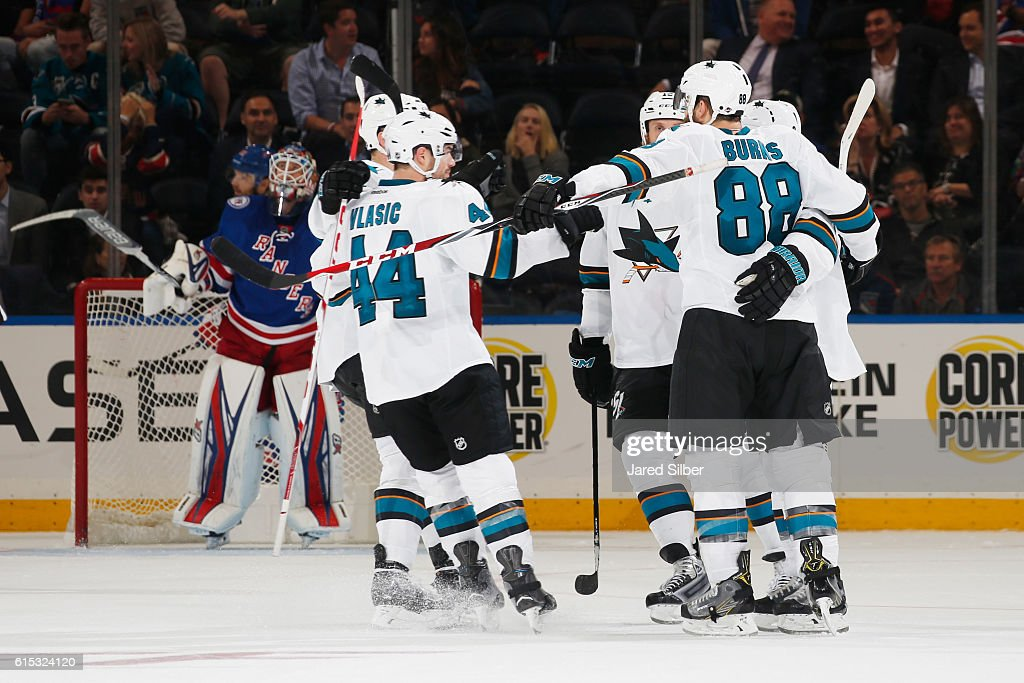 Brent Burns #88, Marc-Edouard Vlasic #44 and Joe Thornton #19 of the San Jose Sharks celebrate after a third period goal against the New York Rangers at Madison Square Garden on October 17, 2016 in New York City.