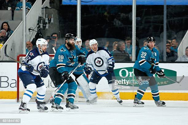 Brent Burns Martin Jones and Logan Couture of the San Jose Sharks defend against Drew Stafford and Bryan Little of the Winnipeg Jets during a NHL...