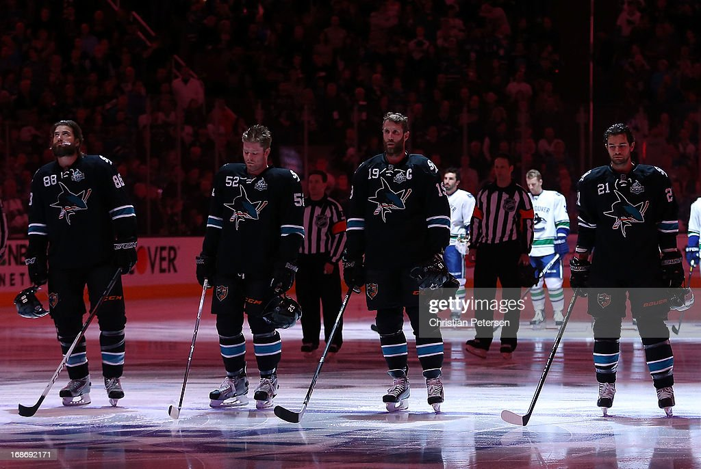 <a gi-track='captionPersonalityLinkClicked' href=/galleries/search?phrase=Brent+Burns&family=editorial&specificpeople=212883 ng-click='$event.stopPropagation()'>Brent Burns</a> #88, Matt Irwin #52, <a gi-track='captionPersonalityLinkClicked' href=/galleries/search?phrase=Joe+Thornton&family=editorial&specificpeople=201829 ng-click='$event.stopPropagation()'>Joe Thornton</a> #19 and <a gi-track='captionPersonalityLinkClicked' href=/galleries/search?phrase=T.J.+Galiardi&family=editorial&specificpeople=4324979 ng-click='$event.stopPropagation()'>T.J. Galiardi</a> #21 of the San Jose Sharks stand attended before Game Four of the Western Conference Quarterfinals against the Vancouver Canucks during the 2013 NHL Stanley Cup Playoffs at HP Pavilion on May 7, 2013 in San Jose, California. The Sharks defeated the Canucks 4-3 to sweep the series 4 games to 0.