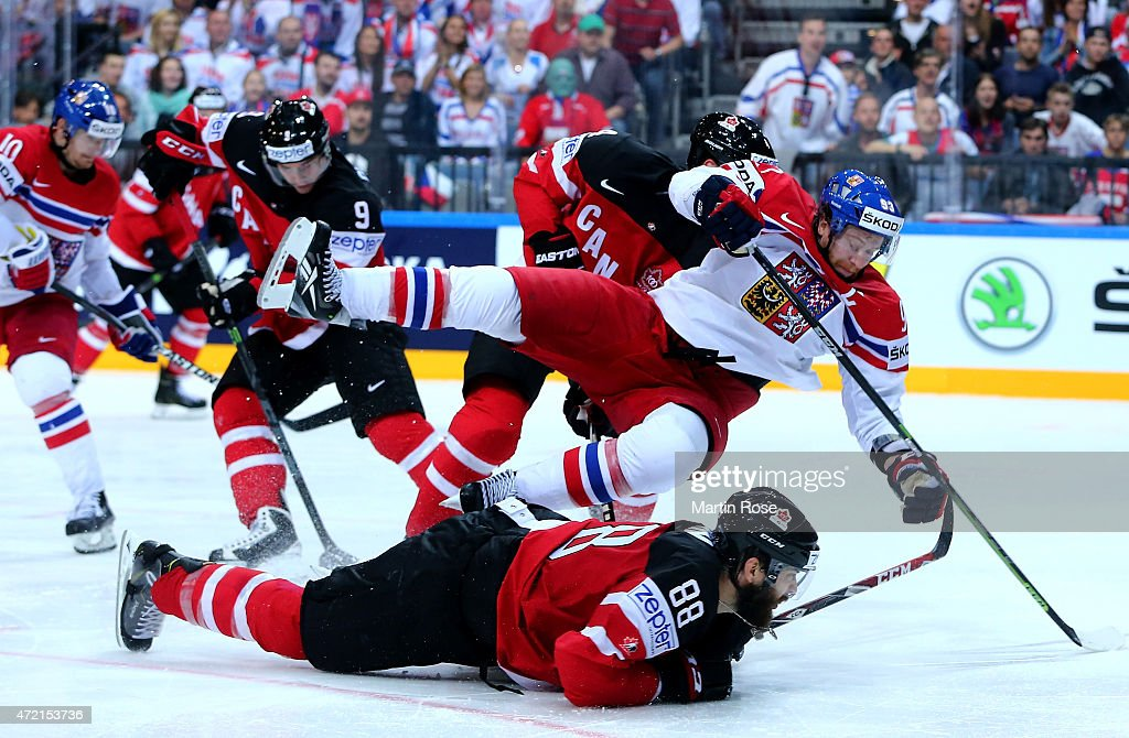 <a gi-track='captionPersonalityLinkClicked' href=/galleries/search?phrase=Brent+Burns&family=editorial&specificpeople=212883 ng-click='$event.stopPropagation()'>Brent Burns</a> #88 of Canada and <a gi-track='captionPersonalityLinkClicked' href=/galleries/search?phrase=Jakub+Voracek&family=editorial&specificpeople=4111797 ng-click='$event.stopPropagation()'>Jakub Voracek</a> #93 of Czech Republic battle for the puck during the IIHF World Championship group A match between Canada and Czecg Republic at o2 Arena on May 4, 2015 in Prague, Czech Republic.