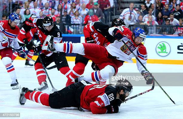 Brent Burns of Canada and Jakub Voracek of Czech Republic battle for the puck during the IIHF World Championship group A match between Canada and...