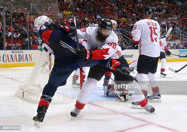 Brent Burns of Team Canada pushes Zach Parise of Team USA off the play during the second period during the World Cup of Hockey tournament at the Air...