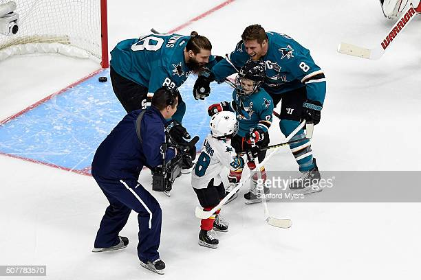 Brent Burns of the San Jose Sharks and Joe Pavelski of the San Jose Sharks skate with their sons Jagger Burns and Nathan Pavelski in the Honda NHL...