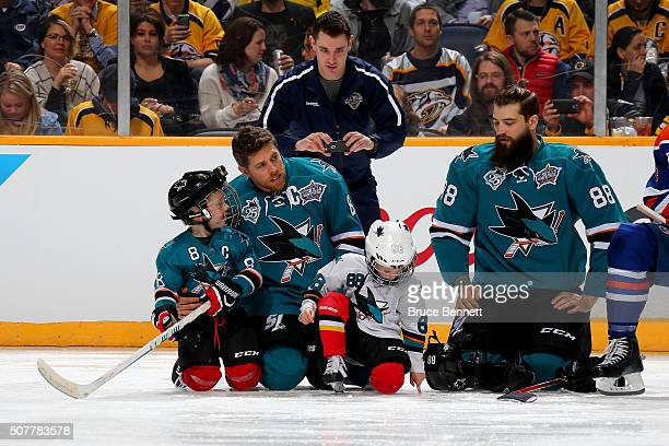 Brent Burns of the San Jose Sharks and Joe Pavelski of the San Jose Sharks talk with their sons Jagger Burns and Nathan Pavelski in the Honda NHL...