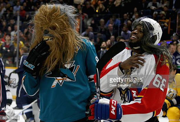 Brent Burns of the San Jose Sharks and P K Subban of the Montreal Canadiens react as they compete in the DraftKings NHL Accuracy Shooting during 2016...