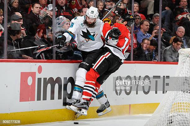 Brent Burns of the San Jose Sharks and Richard Panik of the Chicago Blackhawks get physical in the second period of the NHL game at the United Center...