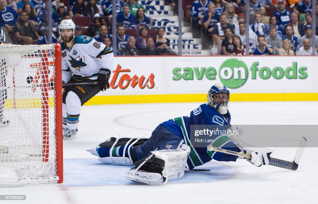 <a gi-track='captionPersonalityLinkClicked' href=/galleries/search?phrase=Brent+Burns&family=editorial&specificpeople=212883 ng-click='$event.stopPropagation()'>Brent Burns</a> #88 of the San Jose Sharks and <a gi-track='captionPersonalityLinkClicked' href=/galleries/search?phrase=Roberto+Luongo&family=editorial&specificpeople=202638 ng-click='$event.stopPropagation()'>Roberto Luongo</a> #1 of the Vancouver Canucks watch a goal made by Raffi Torres #13 of the Sharks (not pictured) during the overtime period in Game Two of the Western Conference Quarterfinals of the 2013 NHL Stanley Cup Playoffs, May 03, 2013 at Rogers Arena in Vancouver, British Columbia, Canada.