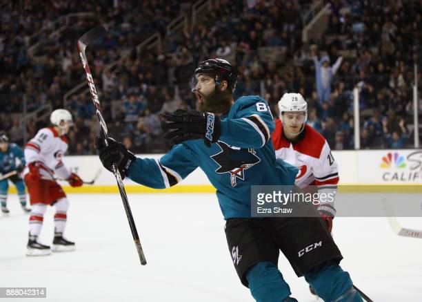 Brent Burns of the San Jose Sharks celebrates after he scored the gamewinning goal on Cam Ward of the Carolina Hurricanes in overtime at SAP Center...