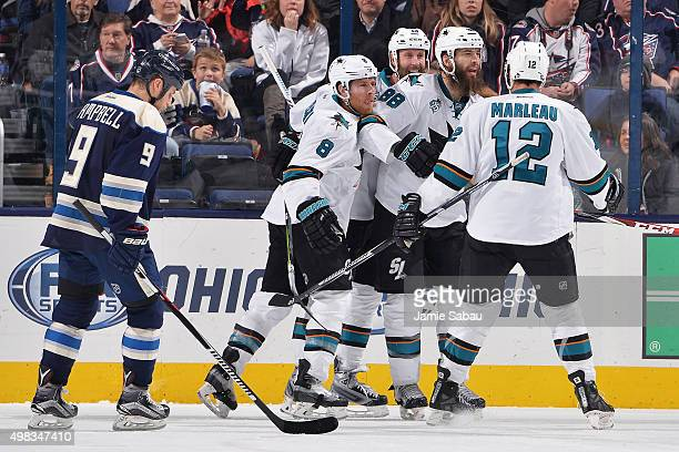 Brent Burns of the San Jose Sharks celebrates his third period goal with teammates Joe Pavelski Joe Thornton and Patrick Marleau of the San Jose...