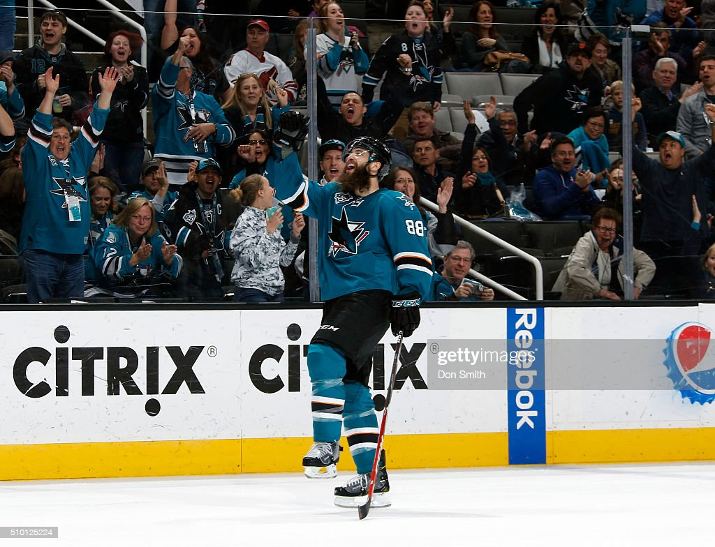 Brent Burns #88 of the San Jose Sharks celebrates the third goal against the Arizona Coyotes during a NHL game at the SAP Center at San Jose on February 13, 2016 in San Jose, California.