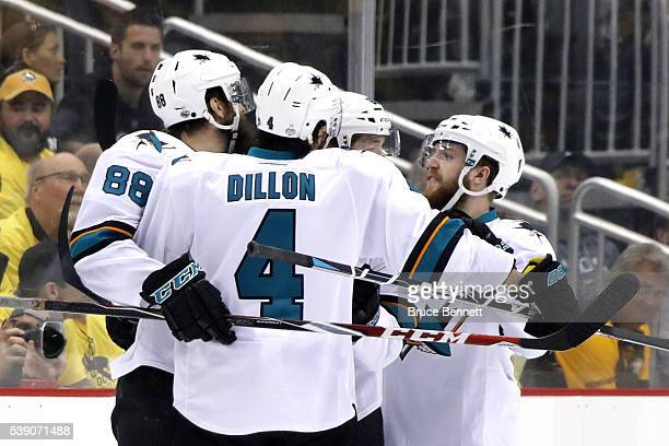 Brent Burns of the San Jose Sharks celebrates with his teammates after scoring a goal against Matt Murray of the Pittsburgh Penguins during the first...