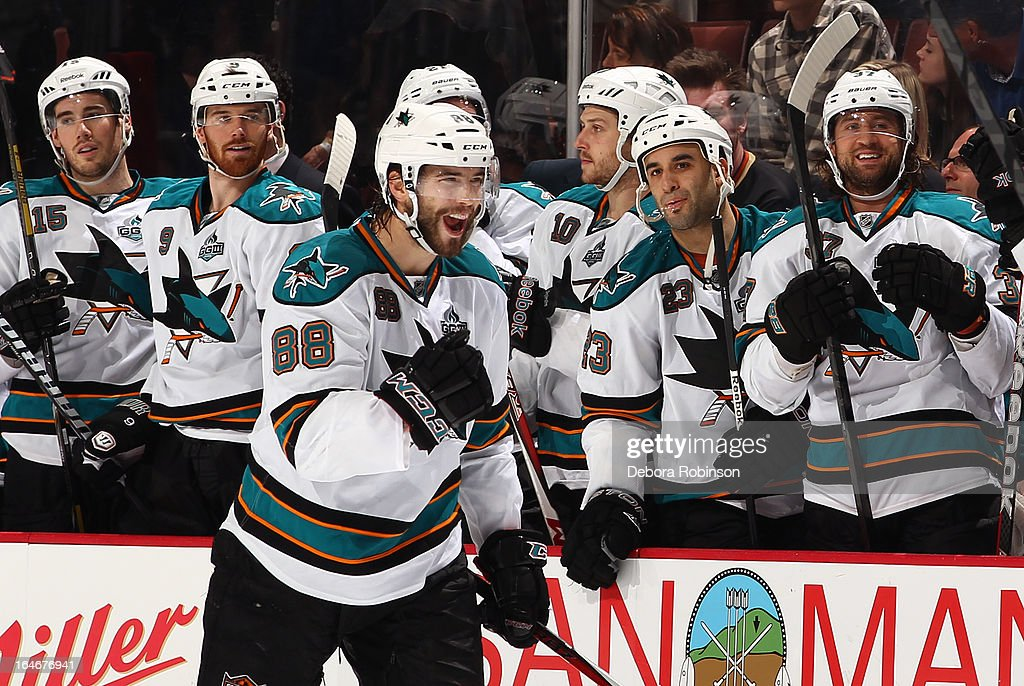 Brent Burns #88 of the San Jose Sharks celebrates with his teammates during the game against the Anaheim Ducks on March 25, 2013 at Honda Center in Anaheim, California.