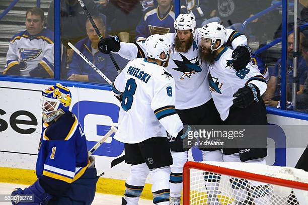 Brent Burns of the San Jose Sharks celebrates with Joe Thornton and Joe Pavelski after scoring a second period goal against Brian Elliott of the St...