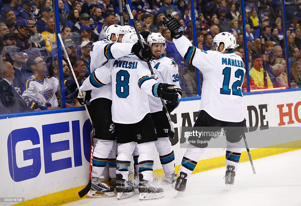 Brent Burns of the San Jose Sharks celebrates with Joe Thornton Joe Pavelski Logan Couture and Patrick Marleau after scoring a second period goal...