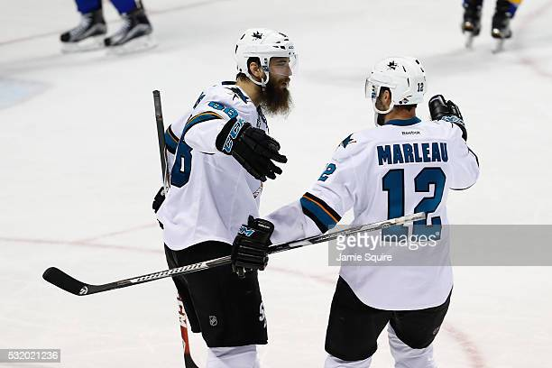 Brent Burns of the San Jose Sharks celebrates with Patrick Marleau after scoring a third period goal against Brian Elliott of the St Louis Blues in...