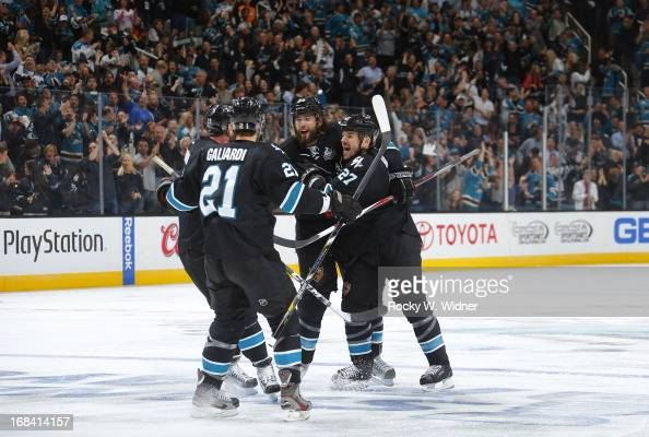 Brent Burns of the San Jose Sharks celebrates with teammates Joe Thornton TJ Galiardi and Scott Hannan after scoring a goal against the Vancouver...
