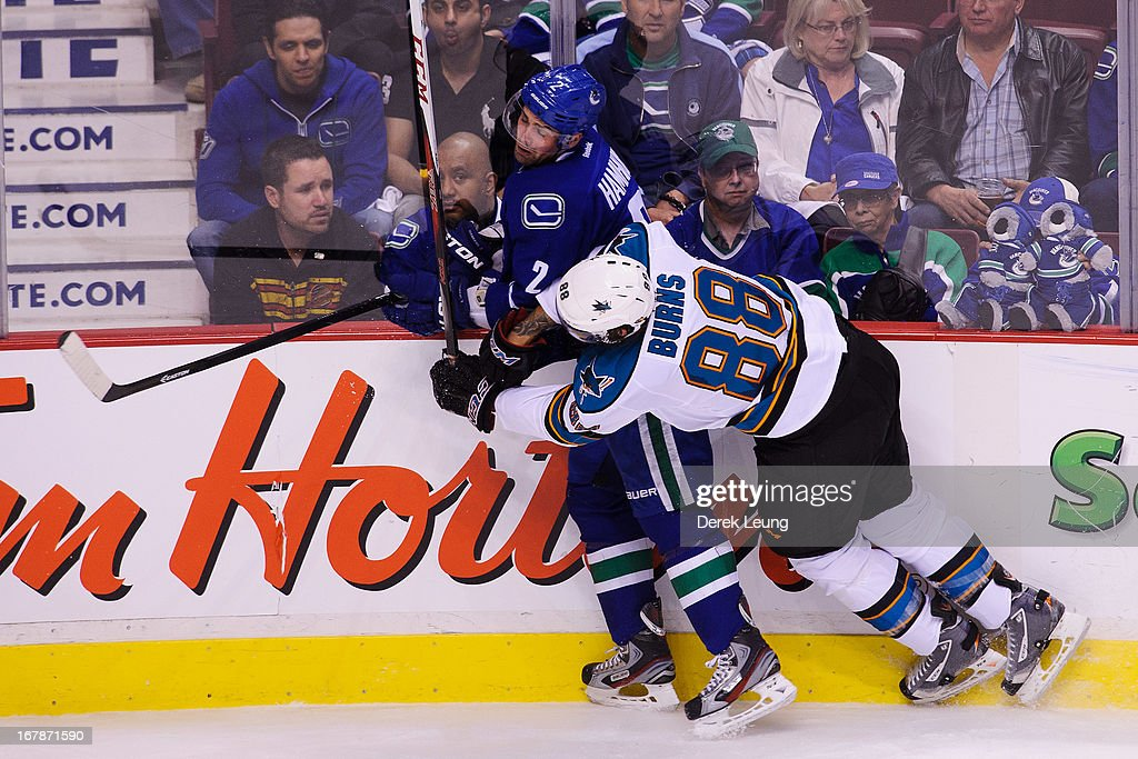 <a gi-track='captionPersonalityLinkClicked' href=/galleries/search?phrase=Brent+Burns&family=editorial&specificpeople=212883 ng-click='$event.stopPropagation()'>Brent Burns</a> #88 of the San Jose Sharks checks <a gi-track='captionPersonalityLinkClicked' href=/galleries/search?phrase=Dan+Hamhuis&family=editorial&specificpeople=204213 ng-click='$event.stopPropagation()'>Dan Hamhuis</a> #2 of the Vancouver Canucks in Game One of the Western Conference Quarterfinals during the 2013 NHL Stanley Cup Playoffs at Rogers Arena on May 1, 2013 in Vancouver, British Columbia, Canada. The San Jose Sharks won 3-1.