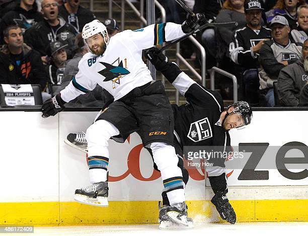 Brent Burns of the San Jose Sharks checks Jake Muzzin of the Los Angeles Kings during the first period in Game Three of the First Round of the 2014...