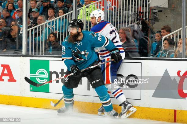 Brent Burns of the San Jose Sharks checks Milan Lucic of the Edmonton Oilers in Game Three of the Western Conference First Round during the 2017 NHL...