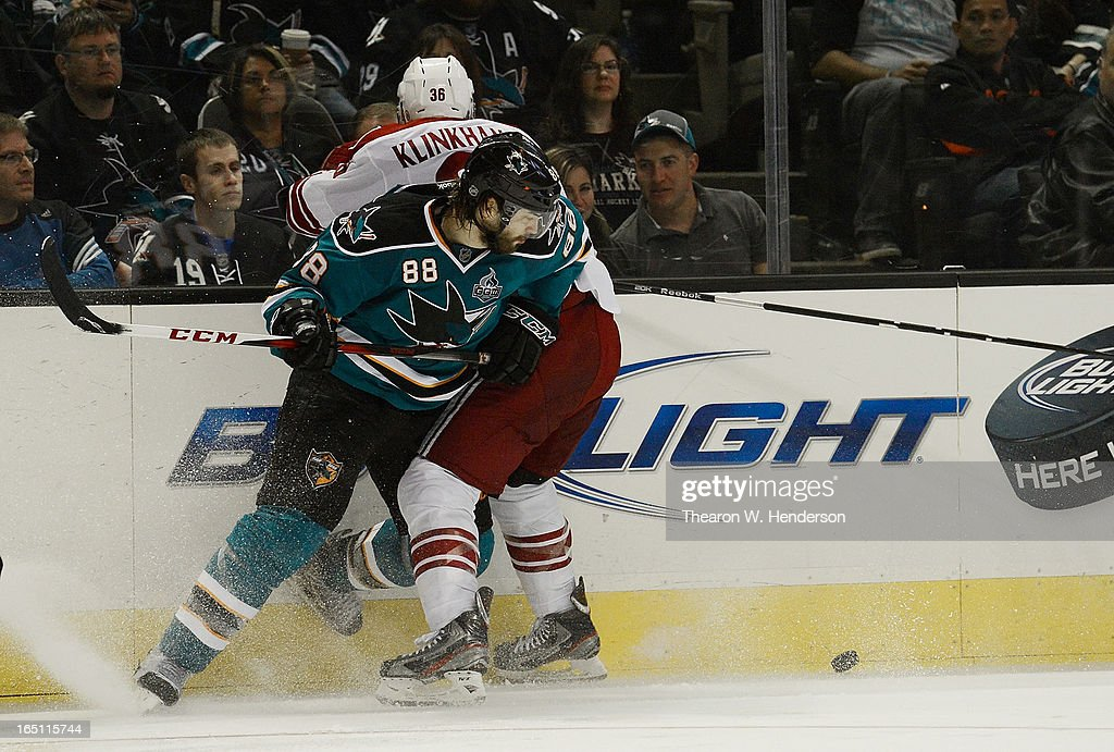 <a gi-track='captionPersonalityLinkClicked' href=/galleries/search?phrase=Brent+Burns&family=editorial&specificpeople=212883 ng-click='$event.stopPropagation()'>Brent Burns</a> #88 of the San Jose Sharks collides up against the boards with <a gi-track='captionPersonalityLinkClicked' href=/galleries/search?phrase=Rob+Klinkhammer&family=editorial&specificpeople=2127064 ng-click='$event.stopPropagation()'>Rob Klinkhammer</a> #36 of the Phoenix Coyotes in the third period at HP Pavilion on March 30, 2013 in San Jose, California. The Sharks won the game in an overtime shoot-out 3-2.