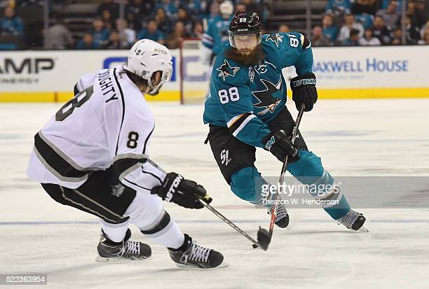 Brent Burns of the San Jose Sharks controling the puck looks to skate past Drew Doughty of the Los Angeles Kings in the second period in Game Three...
