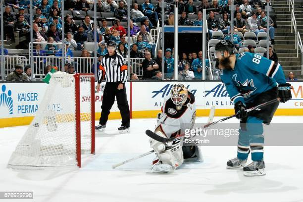 Brent Burns of the San Jose Sharks gets the puck by Reto Berra of the Anaheim Ducks for a shootout goal at SAP Center on November 20 2017 in San Jose...