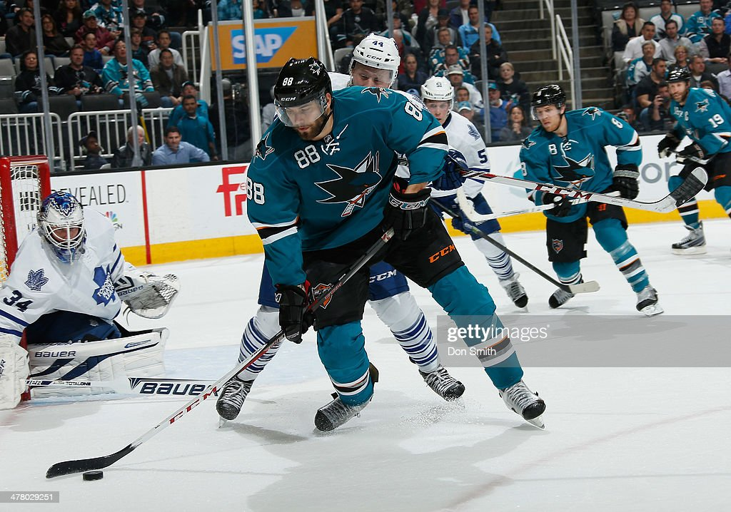 <a gi-track='captionPersonalityLinkClicked' href=/galleries/search?phrase=Brent+Burns&family=editorial&specificpeople=212883 ng-click='$event.stopPropagation()'>Brent Burns</a> #88 of the San Jose Sharks handles the puck against James Reimer #34 of the Toronto Maple Leafs during an NHL game on March 11, 2014 at SAP Center in San Jose, California.