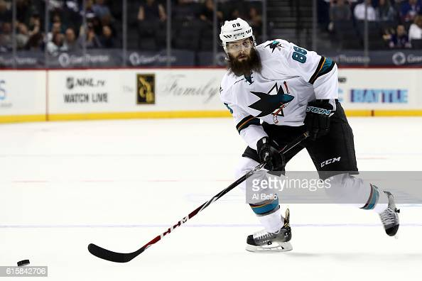 Brent Burns of the San Jose Sharks handles the puck against the New York Islanders at Barclays Center on October 18 2016 in New York City