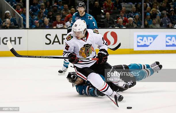Brent Burns of the San Jose Sharks is called for tripping Artemi Panarin of the Chicago Blackhawks in the first period at SAP Center on November 25...