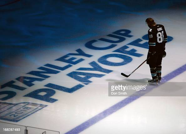 Brent Burns of the San Jose Sharks listens to the National Anthem before a game against the Vancouver Canucks in Game Four of the Western Conference...