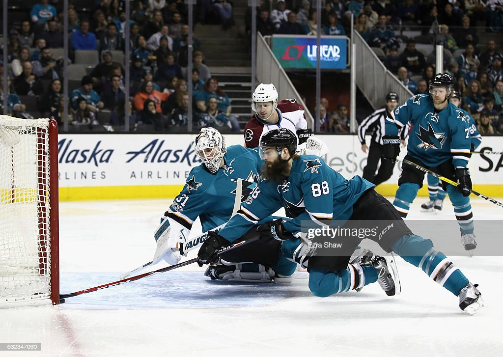 Brent Burns #88 of the San Jose Sharks makes a save on a puck that got past goalie Martin Jones #31 during the first period of their game against the Colorado Avalanche at SAP Center on January 21, 2017 in San Jose, California.