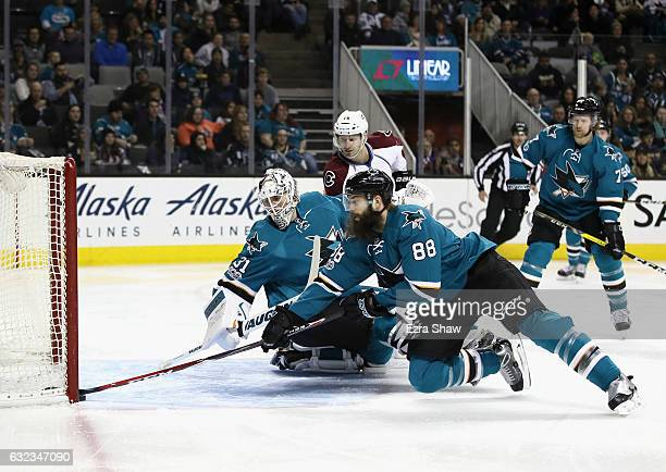 Brent Burns of the San Jose Sharks makes a save on a puck that got past goalie Martin Jones during the first period of their game against the...