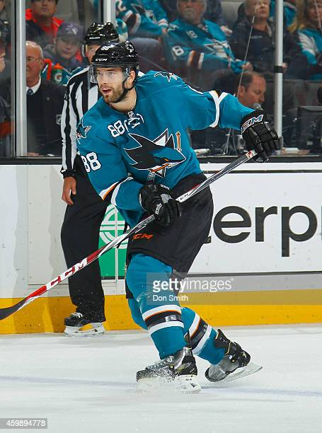 Brent Burns of the San Jose Sharks passes the puck against the Anaheim Ducks during an NHL game on November 29 2014 at SAP Center in San Jose...